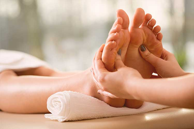Close Up of Young Woman Enjoying a Feet Massage in a Spa