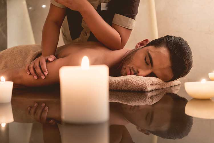 Man Receiving Back Getting Thai Massage in Spa