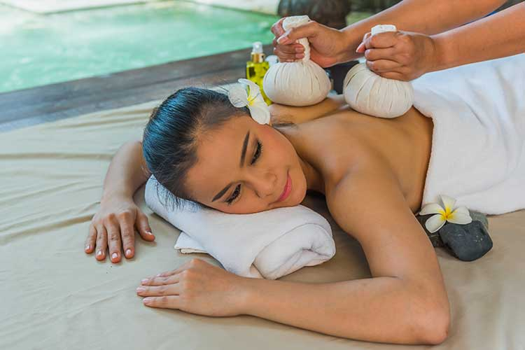 Portrait of young beautiful woman getting thai massage in spa environment, Traditional oriental aroma therapy and beauty treatments