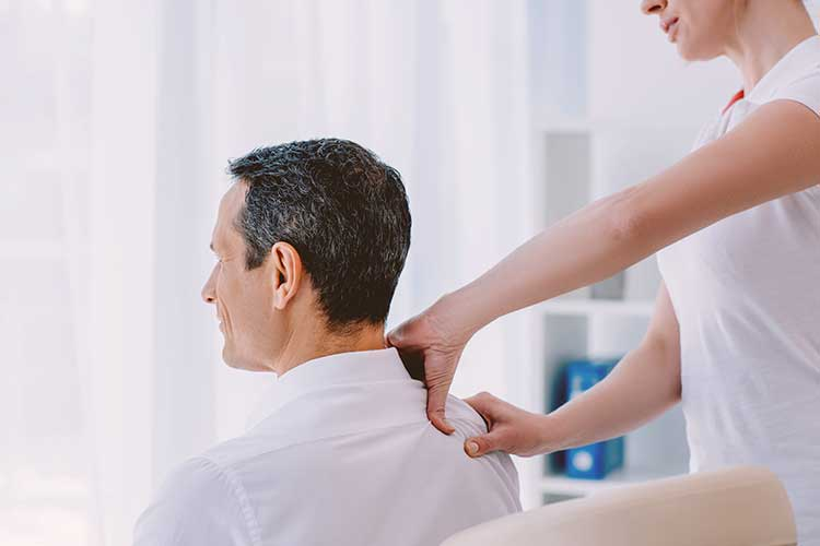 Man Getting Massage at Work By Beautiful Therapist