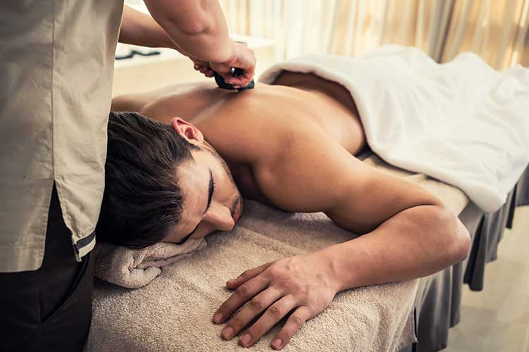 man having massage and bowl of milk , spa salon Beauty treatment